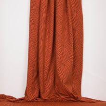 Roestkleurige tricot met abstracte lijnen