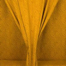 Okergele tricot met abstracte lijnen