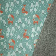 Petrol gemeleerde sweaterstof met vosjes en bomen, achterkant grijs pelsje