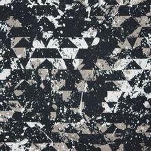 French terry in zwart / grijs met geometrisch motief en verfspatten
