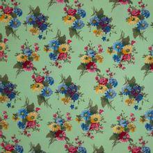 Lichtgroene polyester met bloemen motief