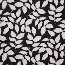 Zwarte polyester met wit bladmotief