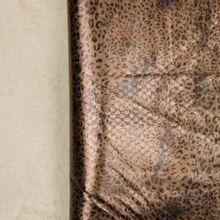 Mantelstof met panterprint en pelsje