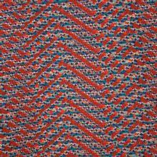 Jacquard in rode en blauwe tinten met lijnen van 'La Maison Victor'
