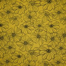 Mosterdkleurige rekbare katoen met zwarte bloemen van Penelope
