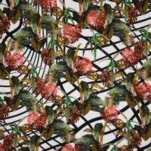 """Witte viscose tricot met print van tropische bladeren """"Tropical Grid"""" van Penelope."""