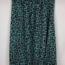 Blauw gemeleerde sweaterstof met pantervlekken en zachte achterkant
