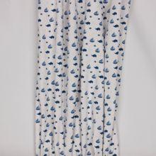 Witte tricot met blauwe 'zee' motieven