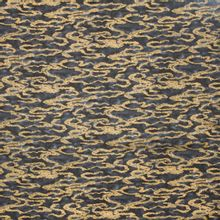 Landschap quilt met donkere wolken en gouddruk