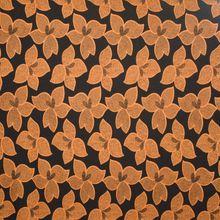 Zwarte viscose  tricot met oker bloemenmotief