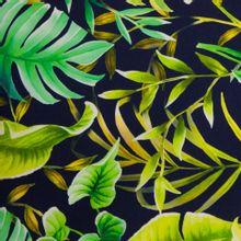 Donker blauwe zware katoentricot met tropische bladeren