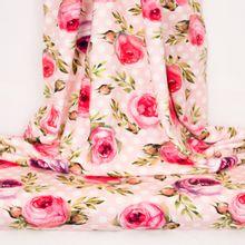 Roze tricot met witte stippen en rozen