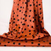 Oranje gesatineerde polyester jacquard stretch met zwarte stippen