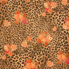 Bruine polyester tricot met panterprint en rozen