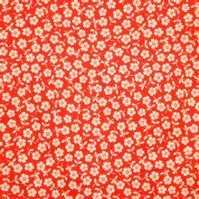 Oranje katoen met witte bloemen