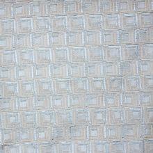 Italiaans jacquard met zilveren en grijs abstract motief