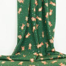 Groene french terry met rendieren en sneeuwvlokken