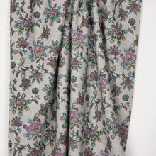Grijze french terry met retro bloemenmotief op de lusjeszijde