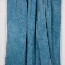 Blauwe rekbare badstof met veelkleurige spikkeltjes van 'Milliblu's'