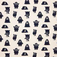 Beige tricot met donker blauwe/zwarte monstertjes 'Theo'