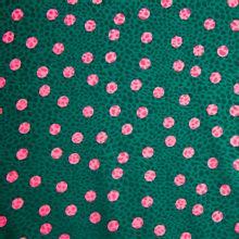 Groene gesatineerde polyester jacquard stretch met roze stippen