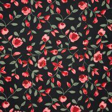 Zwarte viscose met rode bloemen